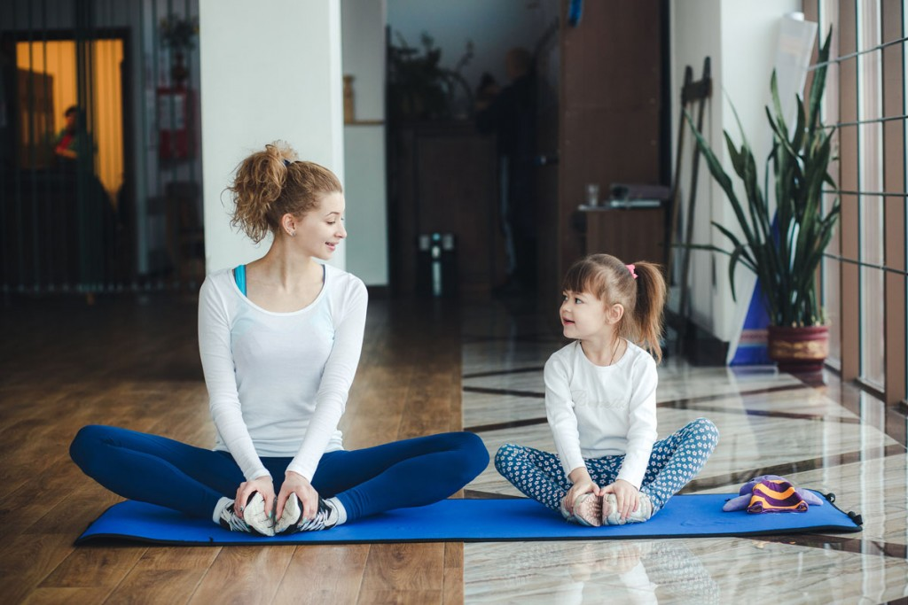 family doing yoga activity together